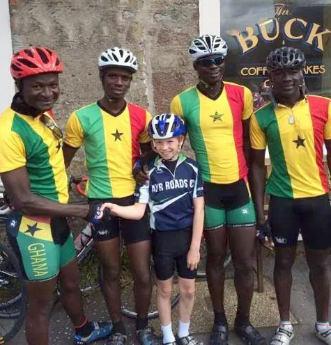 Four members of the Ghanian Cycling team along with a youngster from Ayr Road pose outside the Buck in Straiton