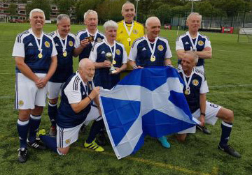 The winning team holding up the saltire